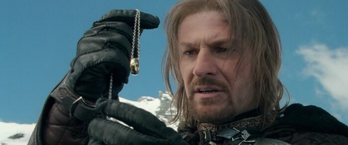 """Movie Boromir (Sean Bean) examines the One Ring in """"The Lord of the Rings: The Fellowship of the Ring"""" (2001)"""